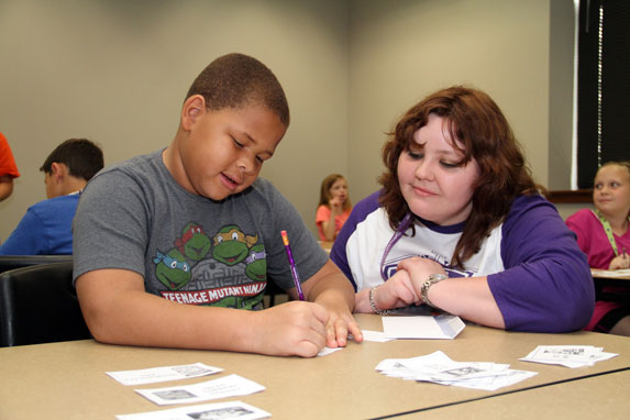M Ed  in Curriculum and Instruction   Tarleton State University Student helping an elementary student with homework